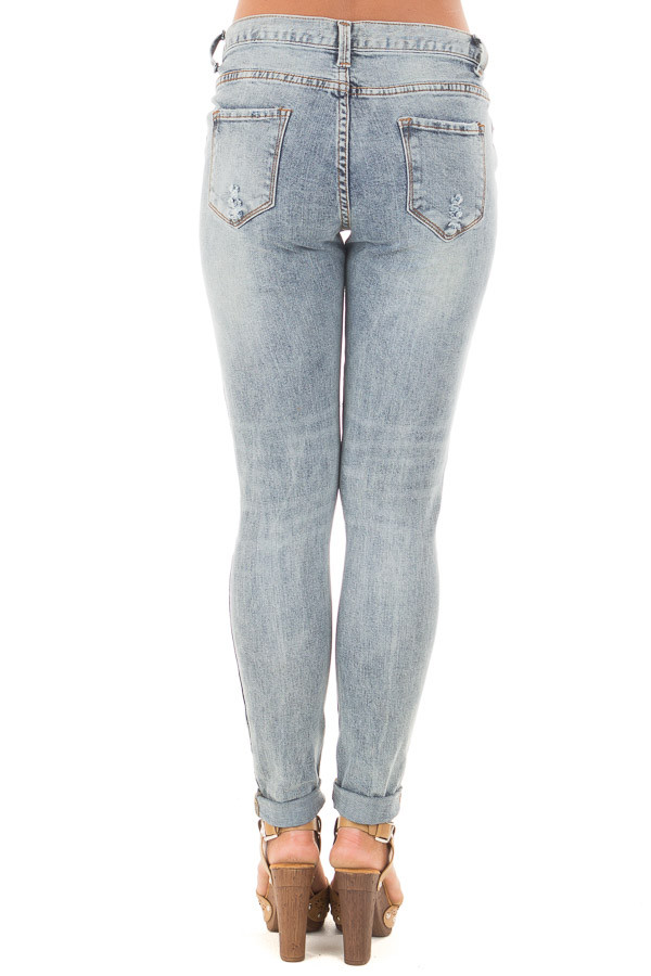 Medium Denim Washed Distressed Mid Rise Skinny Jeans back view