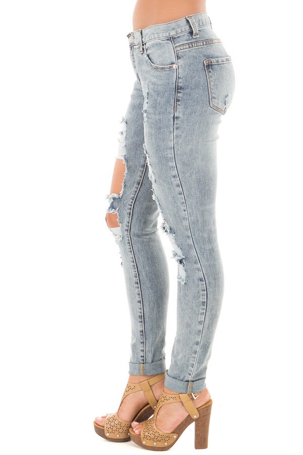 Medium Denim Washed Distressed Mid Rise Skinny Jeans side right leg