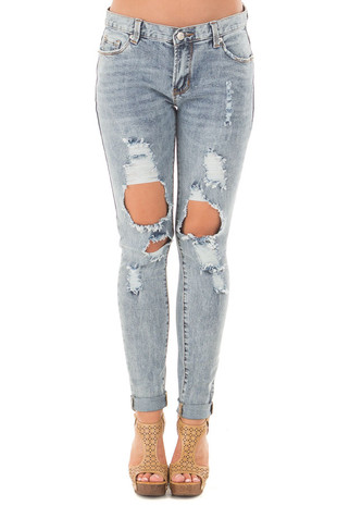 Medium Denim Washed Distressed Mid Rise Skinny Jeans front view