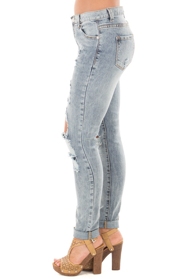 Medium Denim Washed Distressed Mid Rise Skinny Jeans side left leg