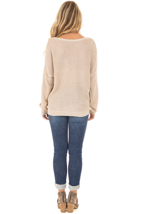 Beige Two Tone Reversible Sweater with Criss Cross Details back full body