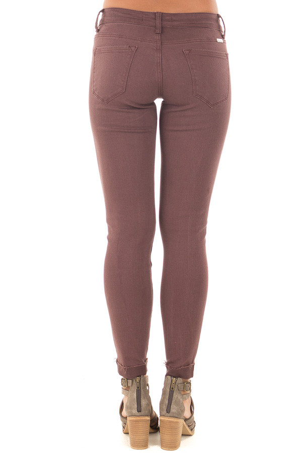 Burgundy Cropped Skinny Jeans with Distressed Details back view