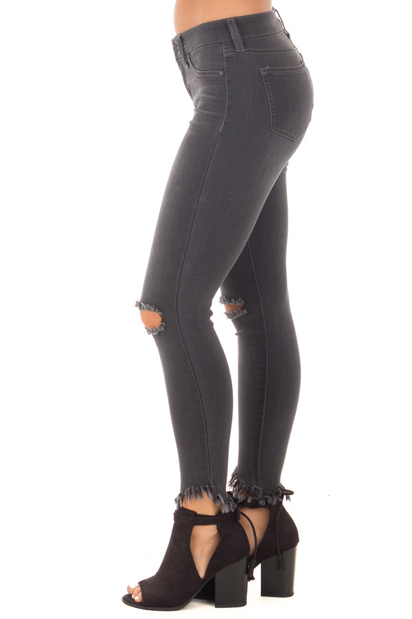 Faded Black Stretchy Skinny Jeans with Ripped Details side left leg