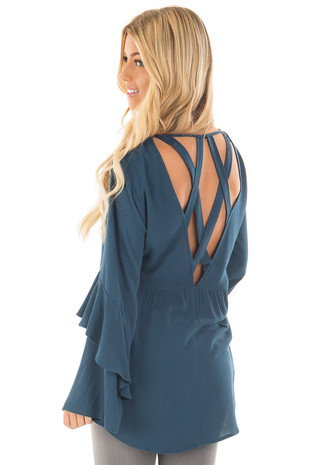 Teal Tunic with Criss Cross Back and Ruffle Sleeve Details back side close up