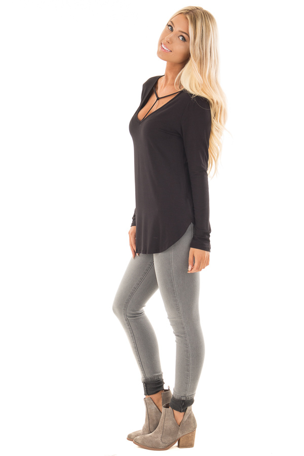 Black Long Sleeve Top with T Strap Neckline Detail side full body