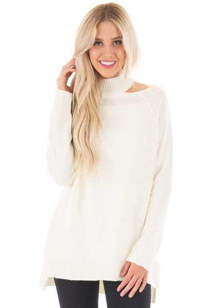Off White Tunic Sweater with Cut Out Details front close up