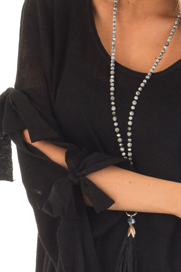 Black Sweater with Cut Out Sleeves and Arm Ties detail