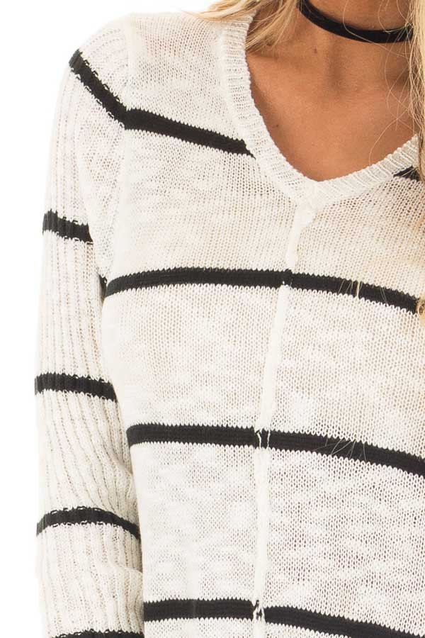 Cream and Black Striped Sweater with Asymmetrical Hem detail