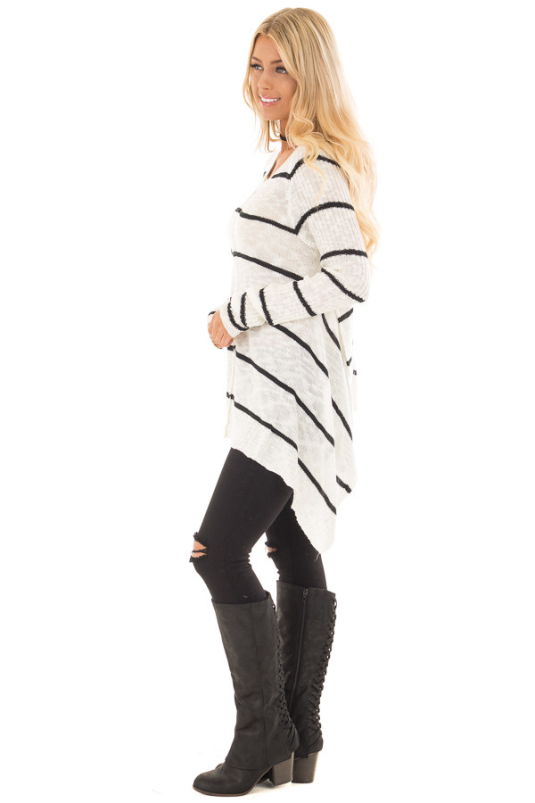 Cream and Black Striped Sweater with Asymmetrical Hem side full body