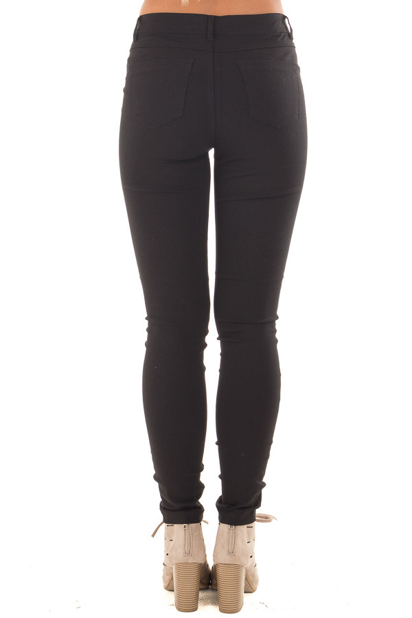 Black Solid Colored Skinny Jeans back view