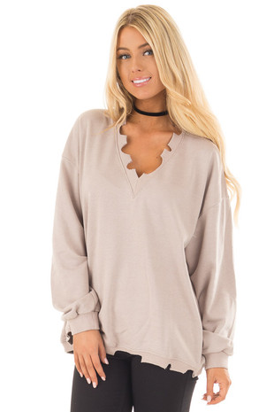 Light Taupe V Neck Sweater with Distressed Details front close up