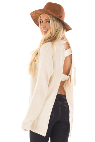 Cream Open Back Sweater with Cut Out V Neck back side close up