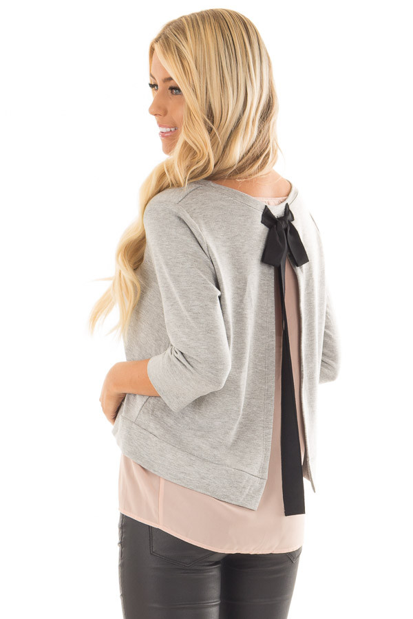 Grey 3/4 Sleeve Top with Blush Chiffon Underlayer and Black Bow back side close up