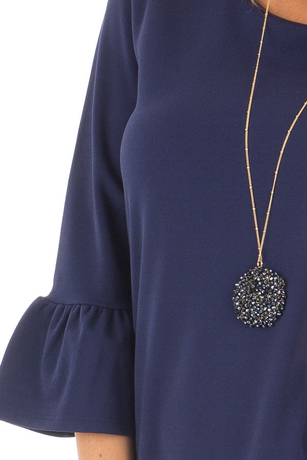 Navy 3/4 Sleeve Dress with Bell Flare Sleeve Detail front detail