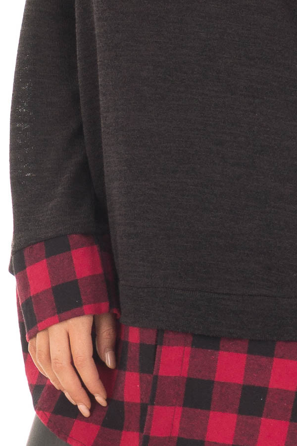 Black Knit Top with Red Plaid Contrast Hem and Cuffs detail