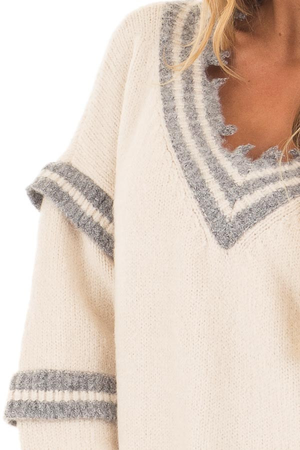 Cream and Grey Varsity Sweater with Distressed Details detail