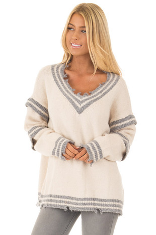 Cream and Grey Varsity Sweater with Distressed Details front close up