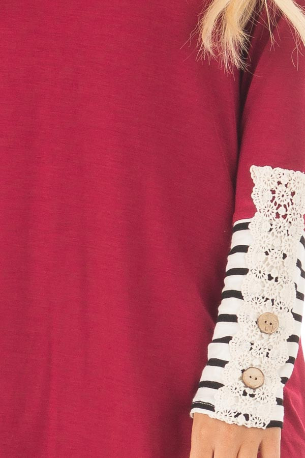 Burgundy Long Sleeve Top with Black and White Stripe Cuffs detail