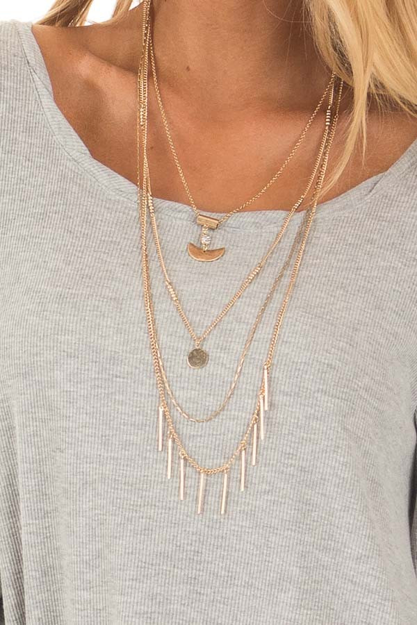 Gold Layered Necklace with Pendant Details close up