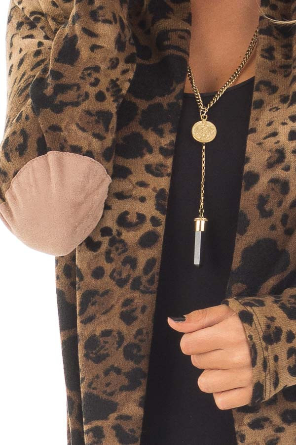 Cheetah Print Cardigan with Faux Suede Elbow Patch Detail front detail
