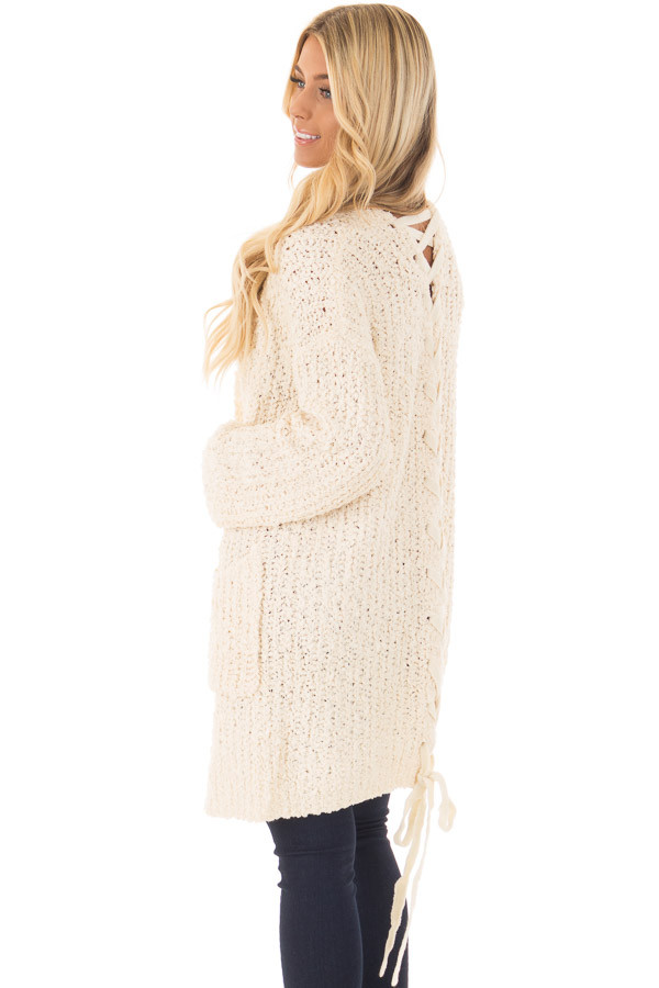 Cream Long Sleeve Lace Up Back Cardigan over the shoulder closeup