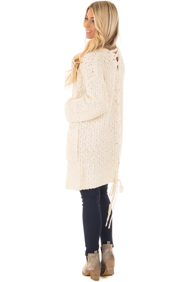 Cream Long Sleeve Lace Up Back Cardigan over the shoulder full body