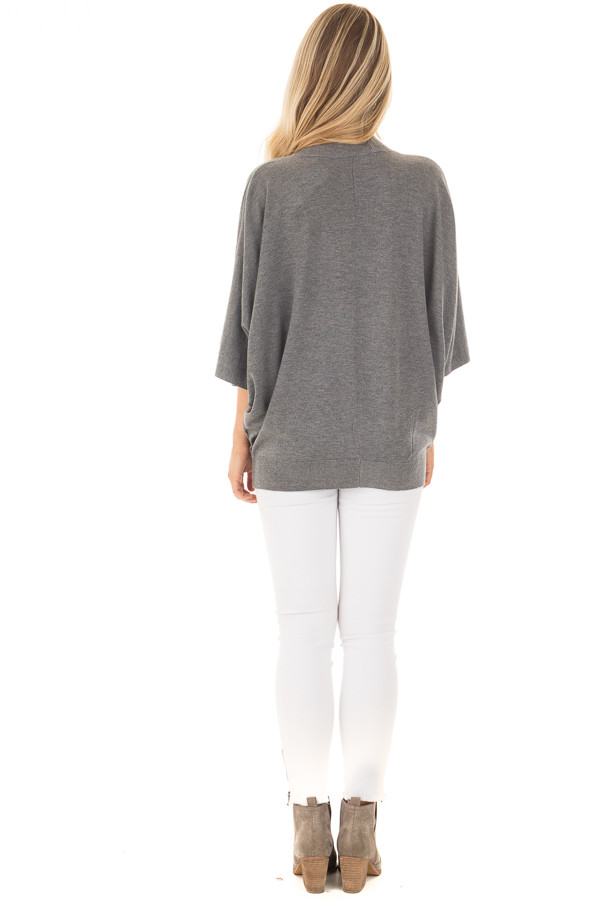 Grey Oversized Top with High Neckline and 3/4 Length Sleeves back full body