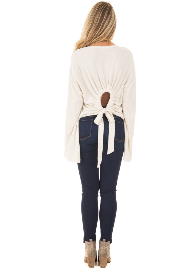 Cream Long Flowy Sleeve Top with Back Circle Tie Detail back full body