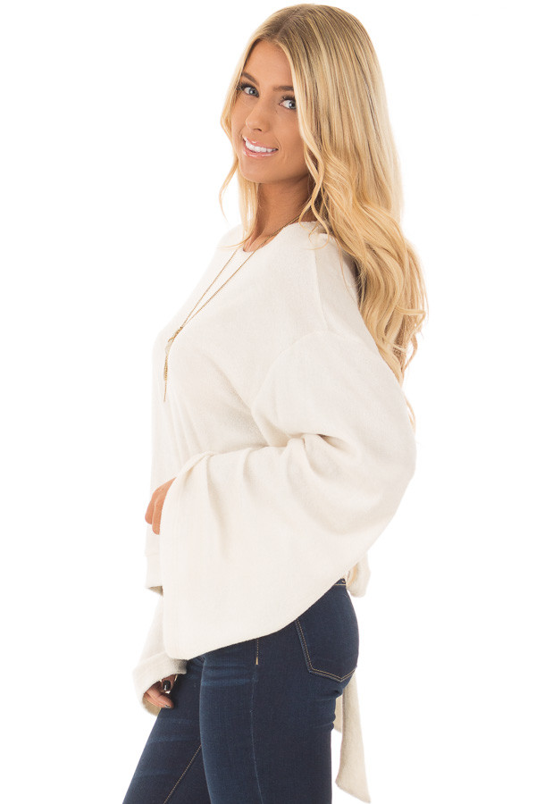 Cream Long Flowy Sleeve Top with Back Circle Tie Detail side closeup