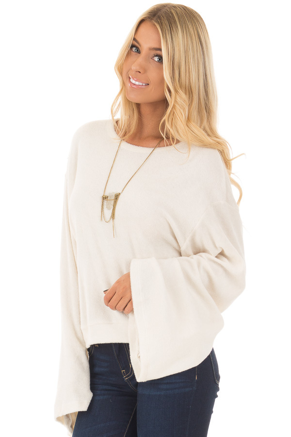 Cream Long Flowy Sleeve Top with Back Circle Tie Detail front closeup