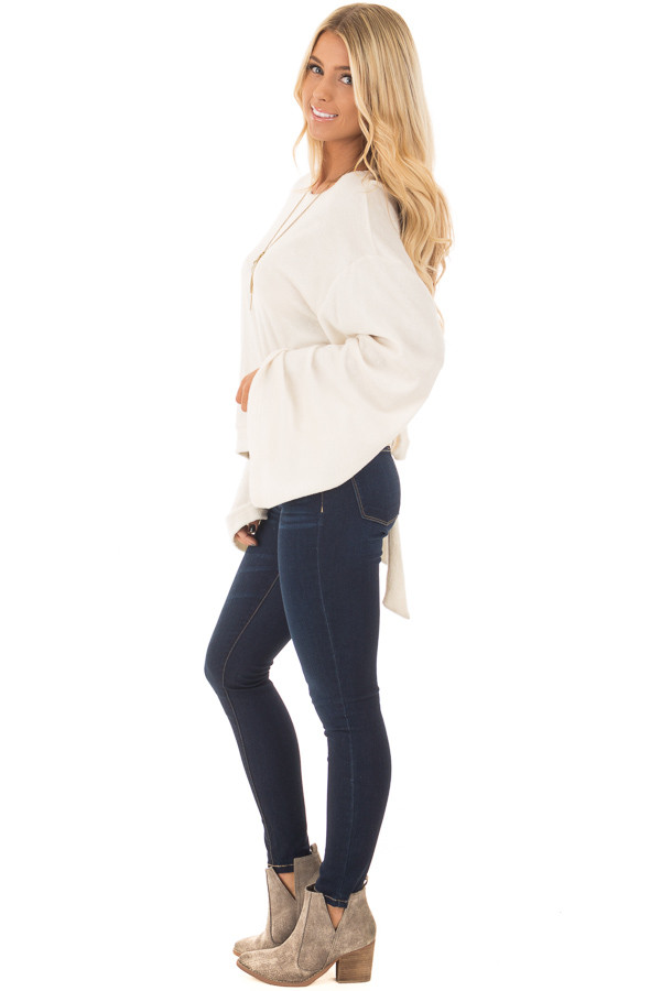 Cream Long Flowy Sleeve Top with Back Circle Tie Detail side full body