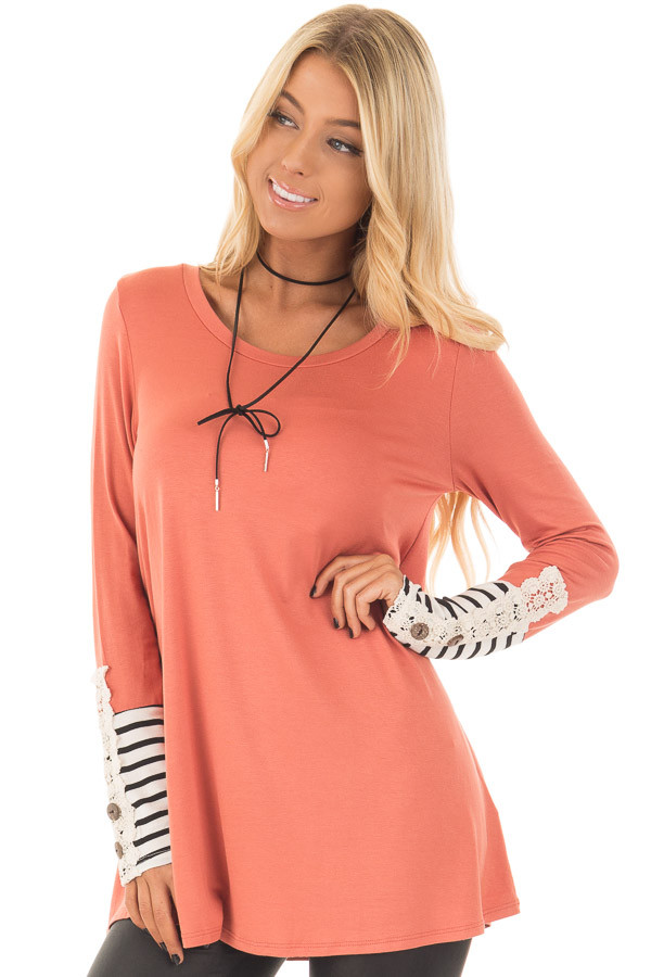 Coral Long Sleeve Top with Black and White Stripe Cuffs front closeup