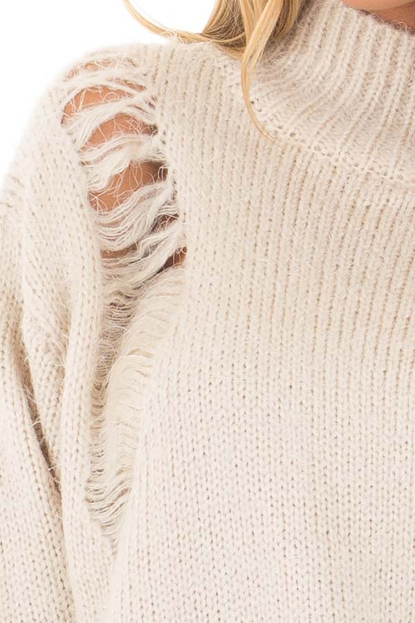 Cream Long Sleeve Distressed Mock Neck Sweater front detail