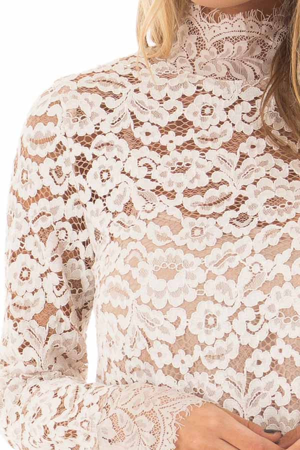 Ivory Floral Lace Up Mock Neck Long Sleeve Top front detail
