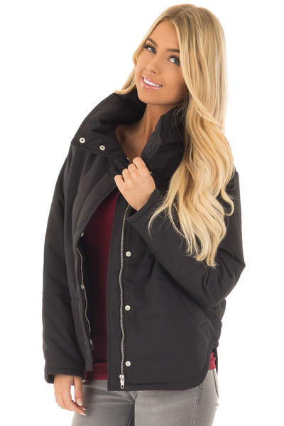 Black Padded Jacket with Rounded Hemline front close up