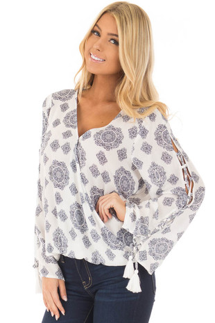 Off White V Neck Top with Navy Pattern and Tassel Detail front closeup