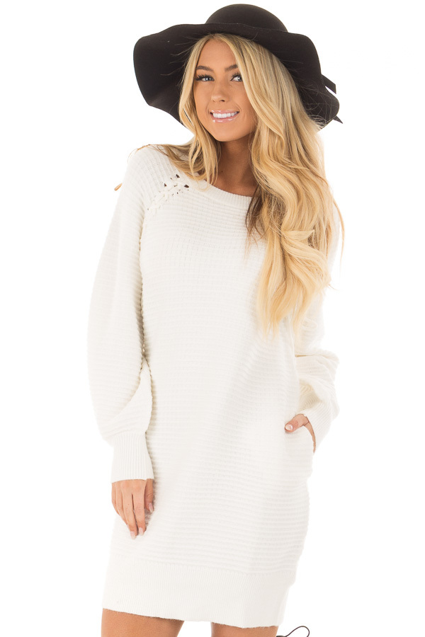 Ivory Sweater Dress with Lace Up Details front closeup