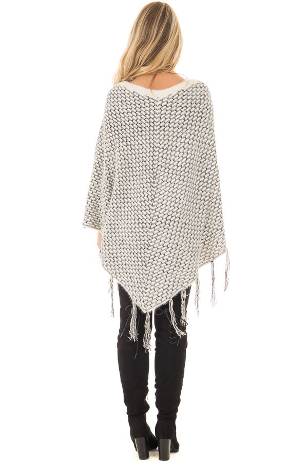 Cream Poncho with Fringe Detail back full body