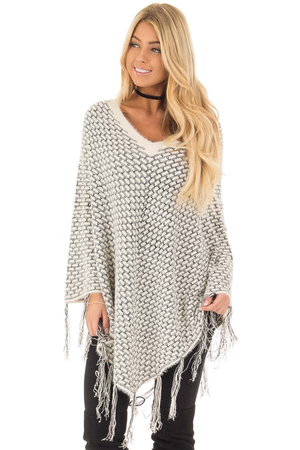 Cream Poncho with Fringe Detail front closeup