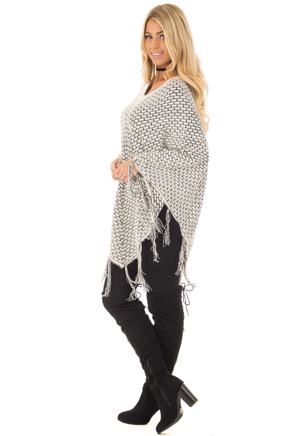 Cream Poncho with Fringe Detail side full body