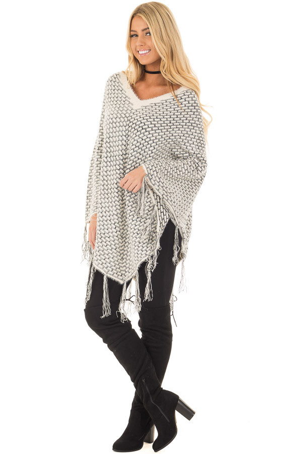 Cream Poncho with Fringe Detail front full body