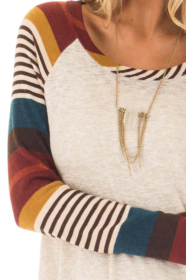 Oatmeal Top with Burgundy and Mustard Raglan Sleeves front detail
