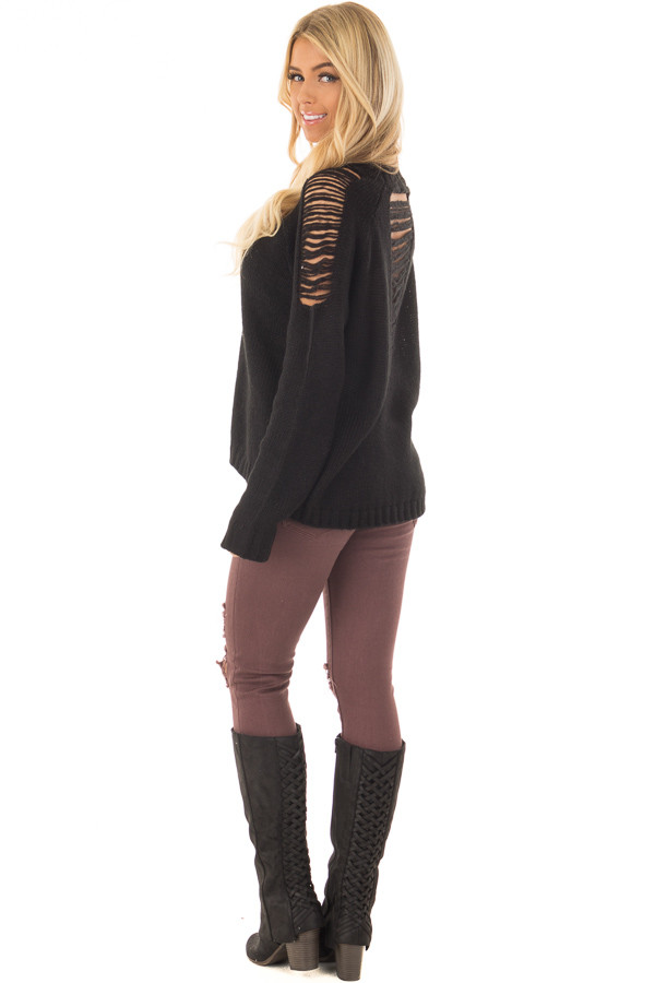 Black Sweater with Distressed Details on Shoulders and Back over the shoulder full body