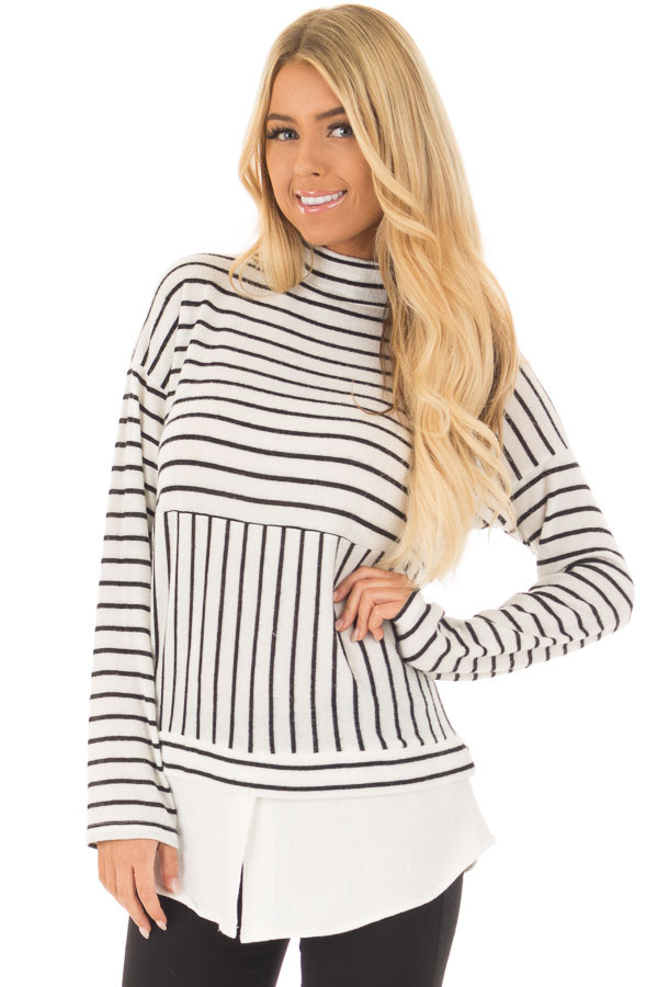Black and White Striped Mock Neck Top with Contrast Hemline front closeup