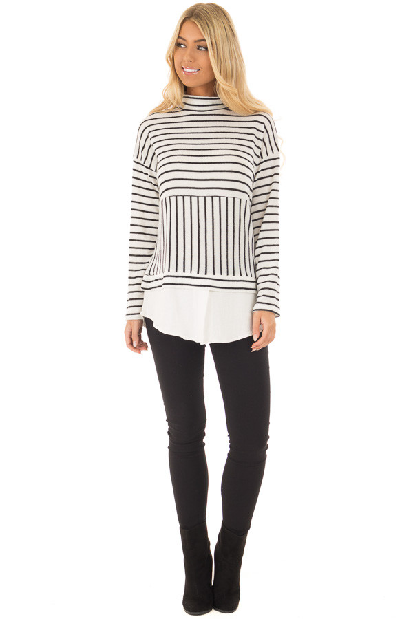Black and White Striped Mock Neck Top with Contrast Hemline front full body