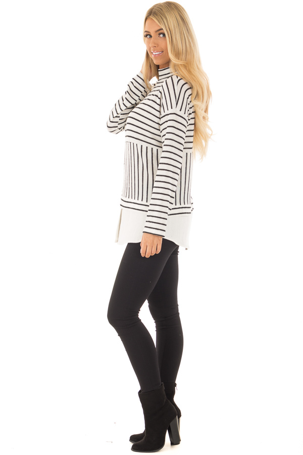 Black and White Striped Mock Neck Top with Contrast Hemline side full body