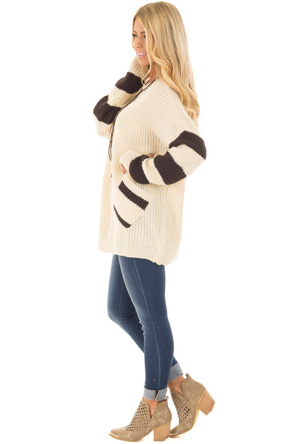 Ivory Oversized Sweater with Front Pockets and Stripe Detail side full body