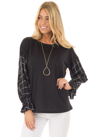 Black Top with Black and White Checkered Long Sleeves front close up