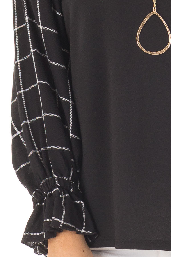 Black Top with Black and White Checkered Long Sleeves detail