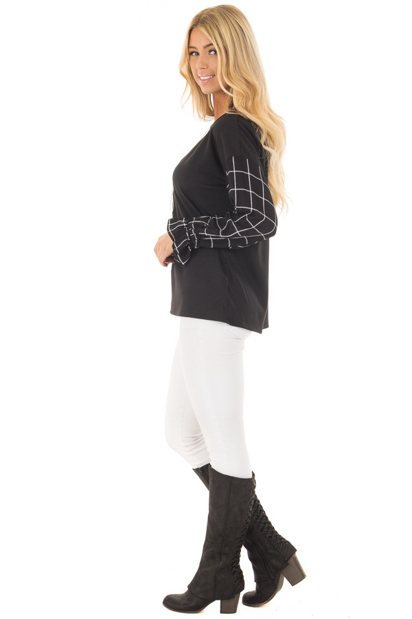 Black Top with Black and White Checkered Long Sleeves side full body